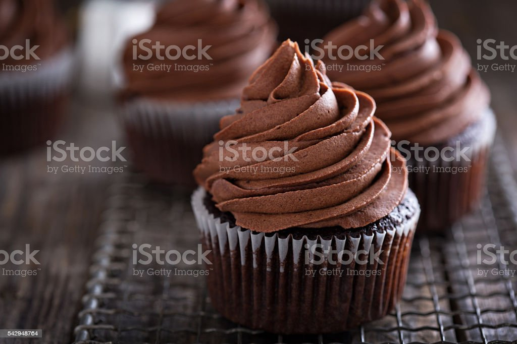Chocolate cupcakes with whipped ganache stock photo