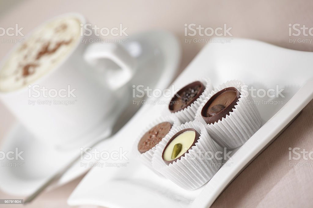Chocolate cups and coffee stock photo