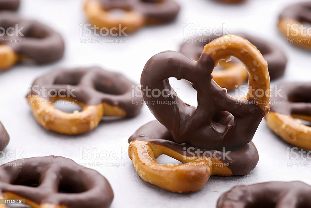 Chocolate dipped pretzels on a baking sheet stock photo