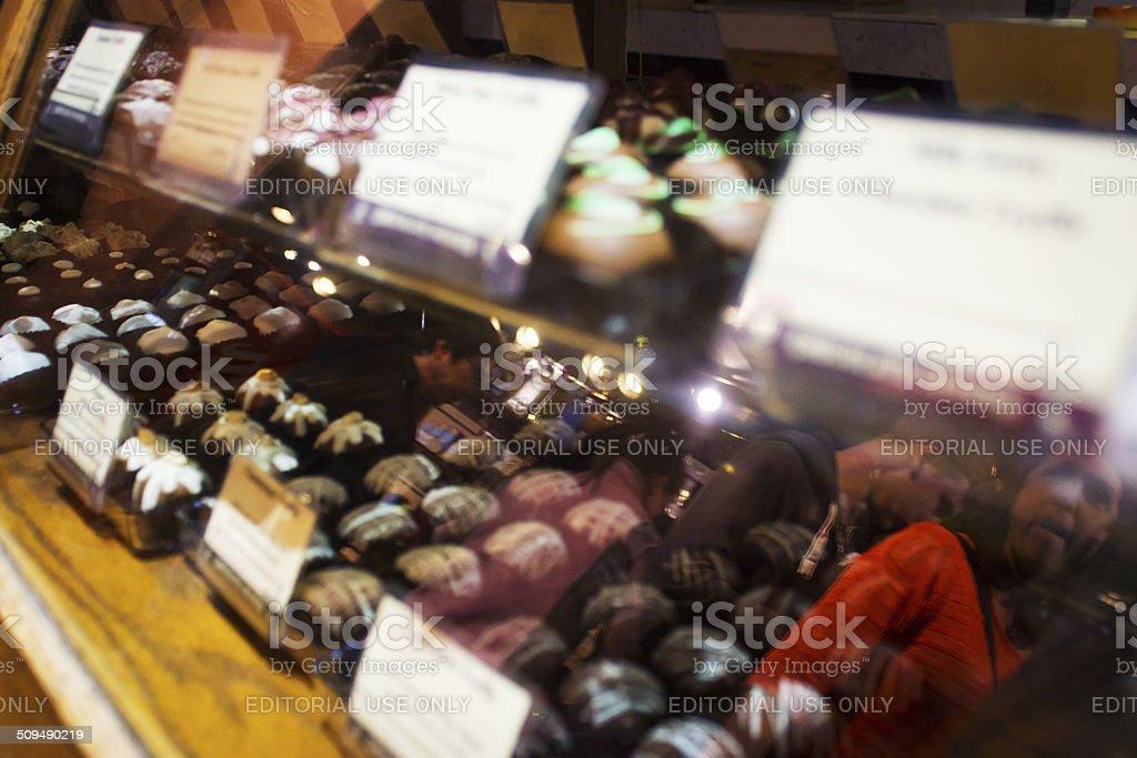 Chocolate display in a shop window stock photo