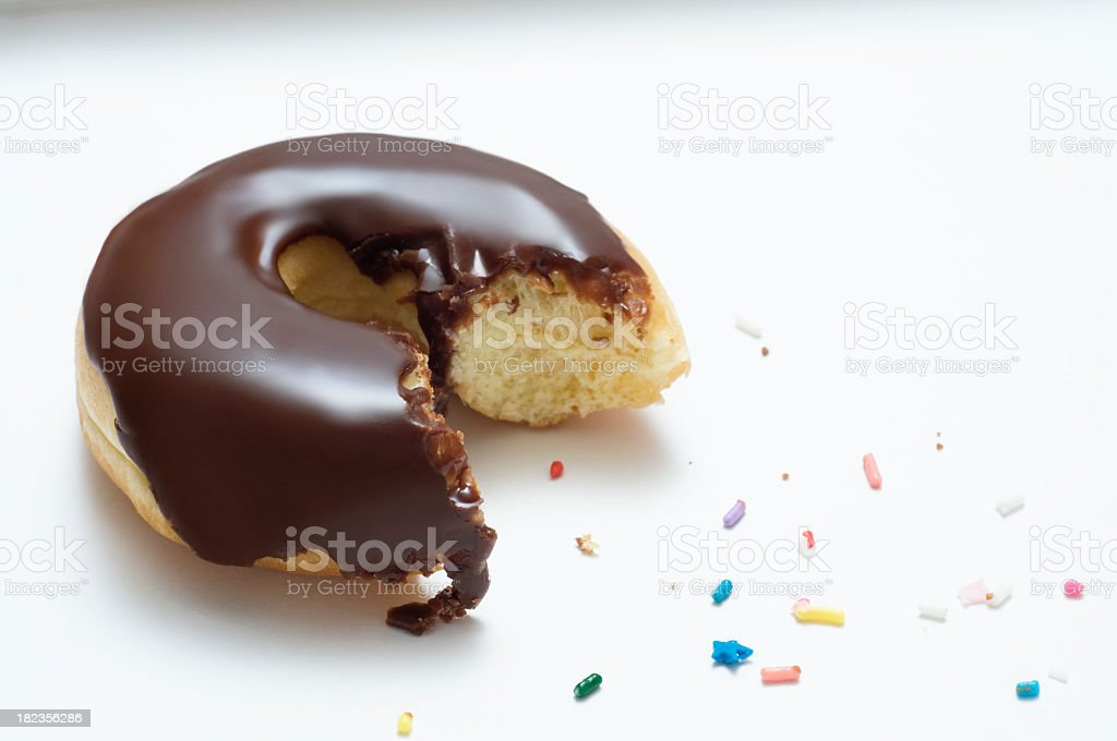 Chocolate Donut With a Bite Taken Out of It royalty-free stock photo