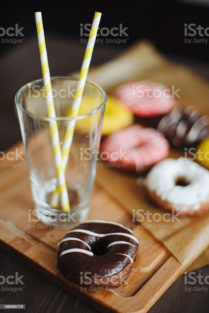Chocolate donut with glass close up stock photo