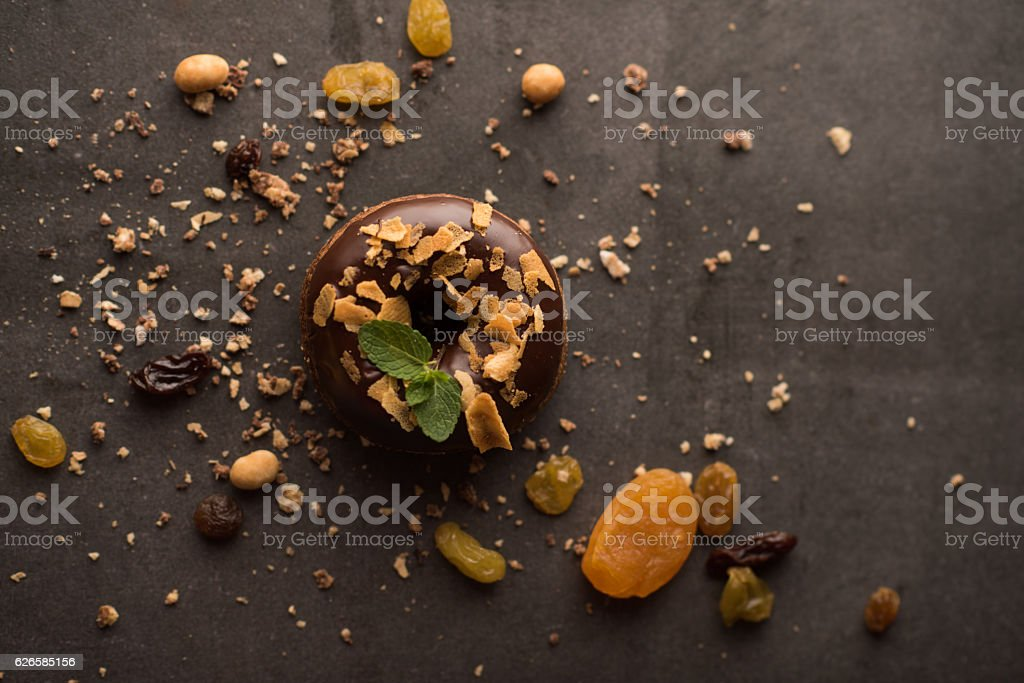 Chocolate Donut with mint leaf and nuts stock photo