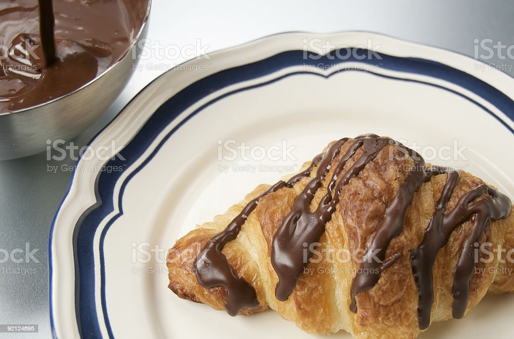 Chocolate Drizzled Croissant royalty-free stock photo