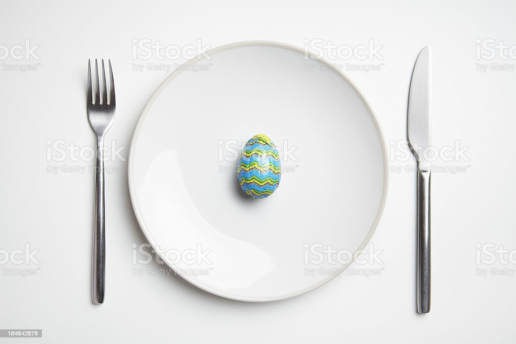 Chocolate easter egg on plate royalty-free stock photo