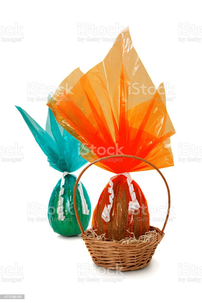 Chocolate Easter Eggs into and out a basket royalty-free stock photo