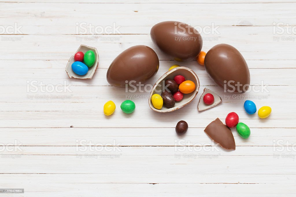 Chocolate Easter Eggs Over Wooden Background stock photo