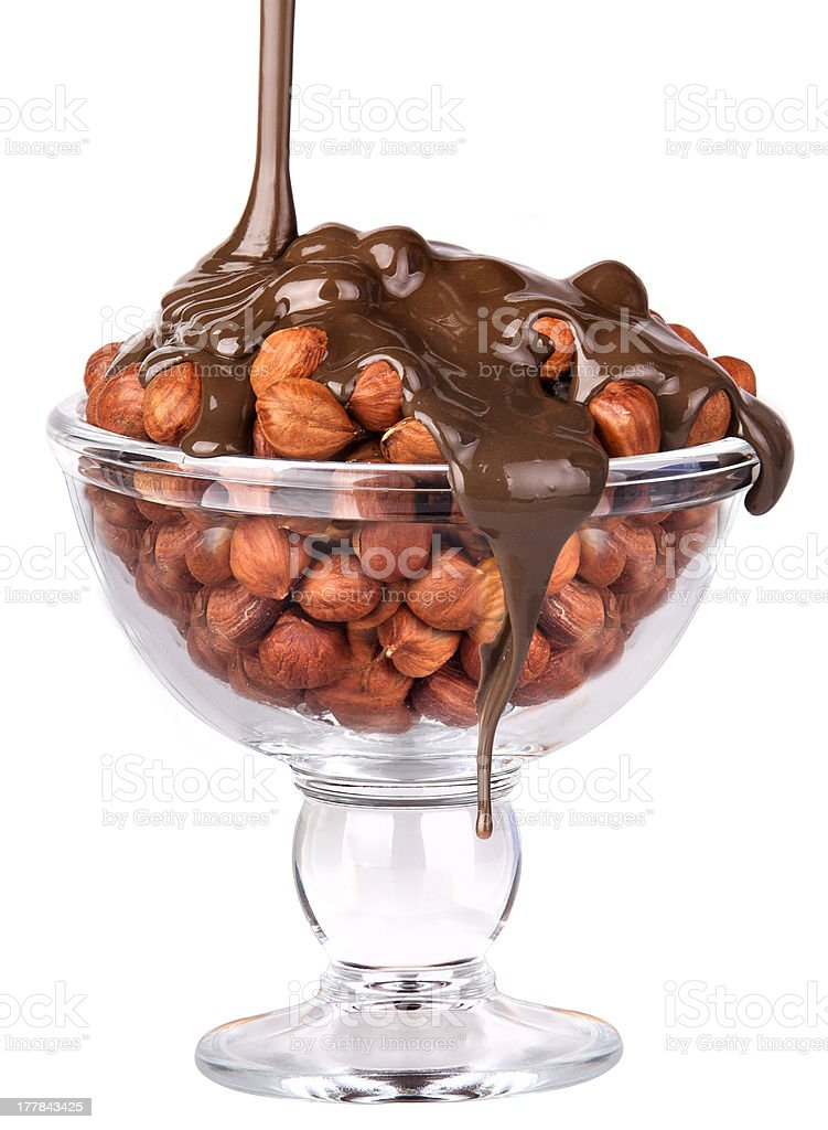 Chocolate Flowing over nuts in a glass  Isolated royalty-free stock photo