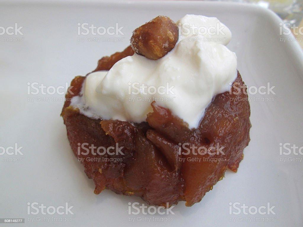 Chocolate fondant cake, vanilla ice-cream, praline hazelnut tuile, dried-raspberry pieces stock photo