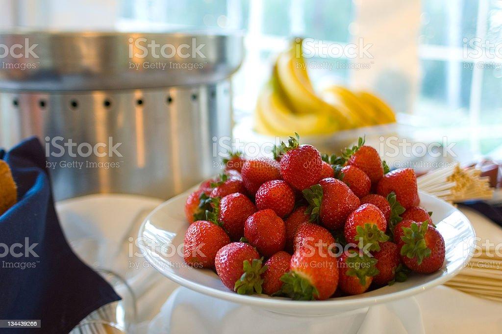 Chocolate Fondue with Bowl of Fresh Strawberries and Bananas stock photo