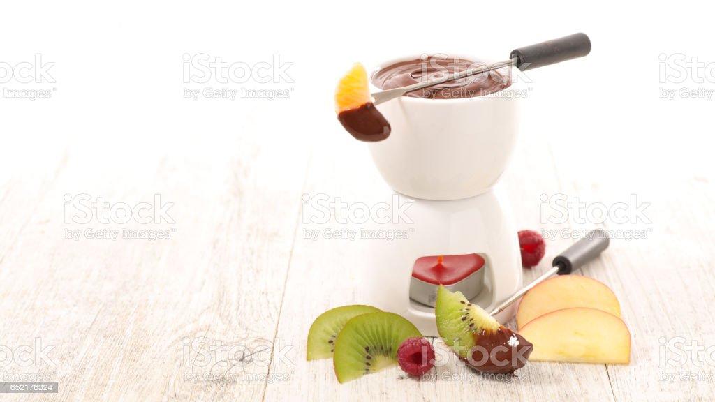 chocolate fondue with fruits stock photo