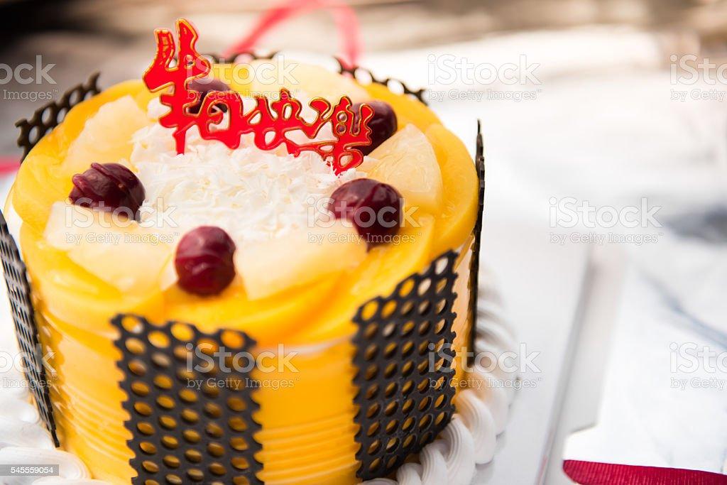 Chocolate fruit birthday cake Background stock photo