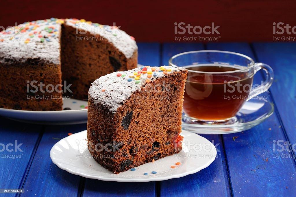 Chocolate fruit cake with black tea on blue table stock photo