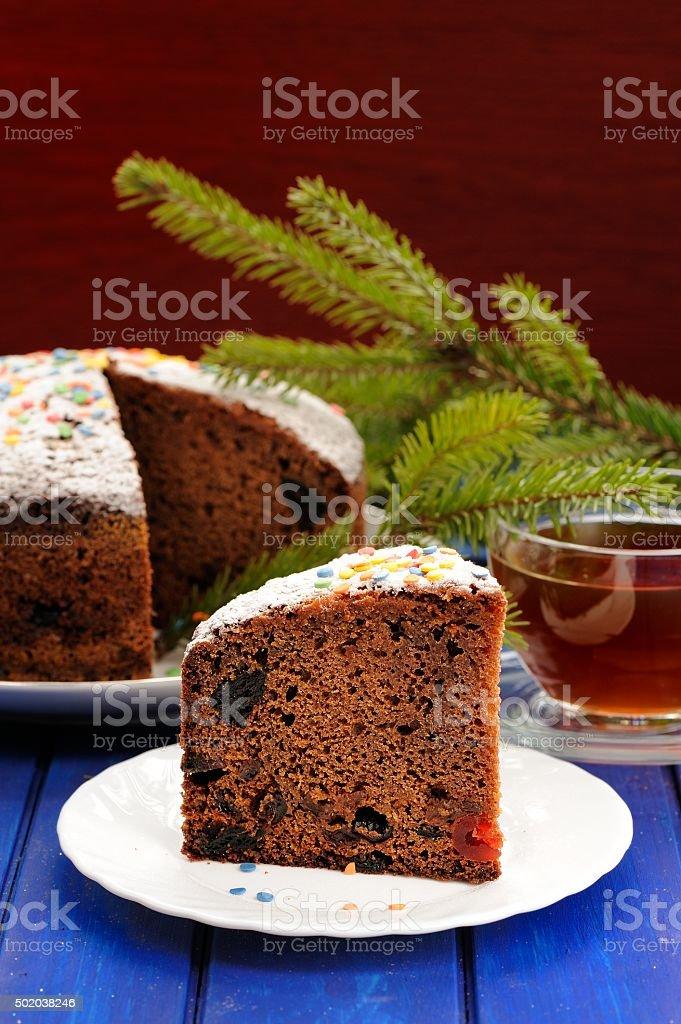 Chocolate fruit christmas cake with green fur tree branch stock photo