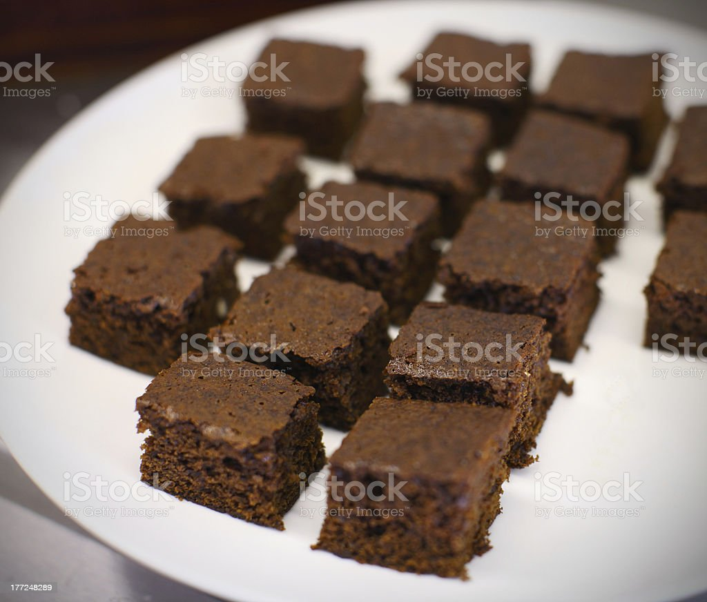 Chocolate gingerbread squares on the plate royalty-free stock photo