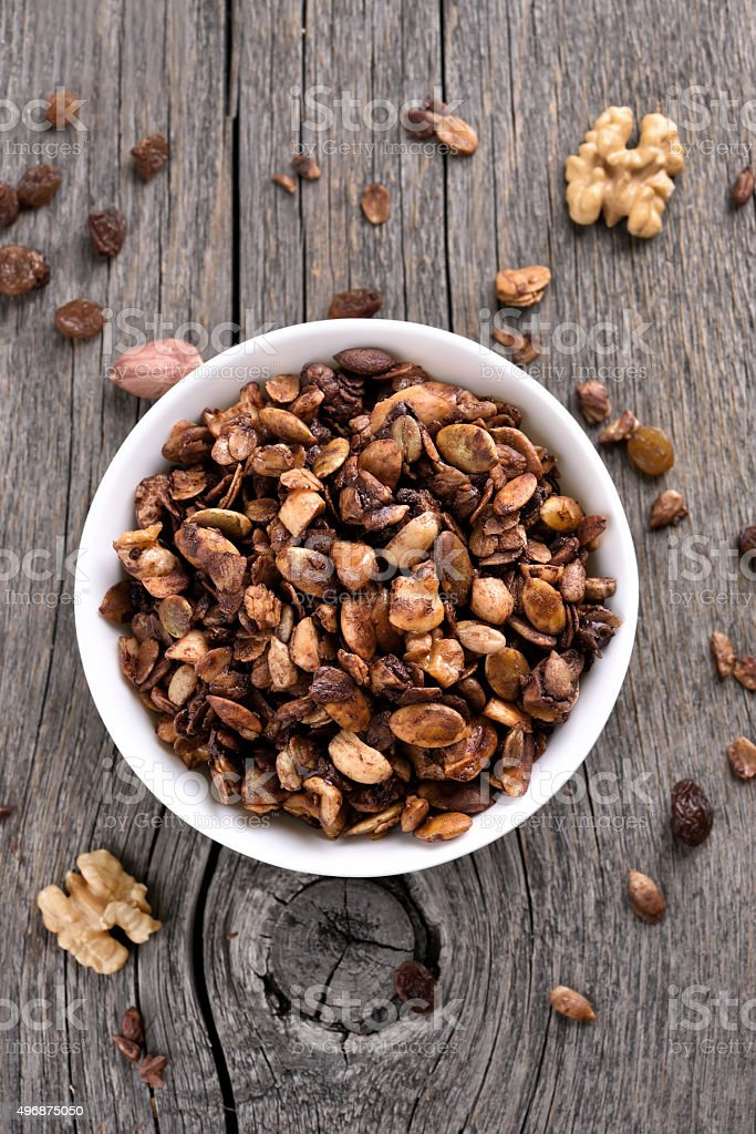 Chocolate granola on wooden background, top view stock photo