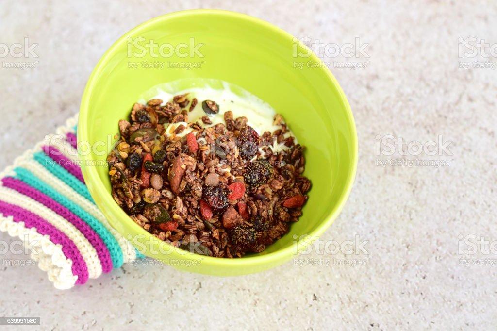 Chocolate granola with yogurt stock photo