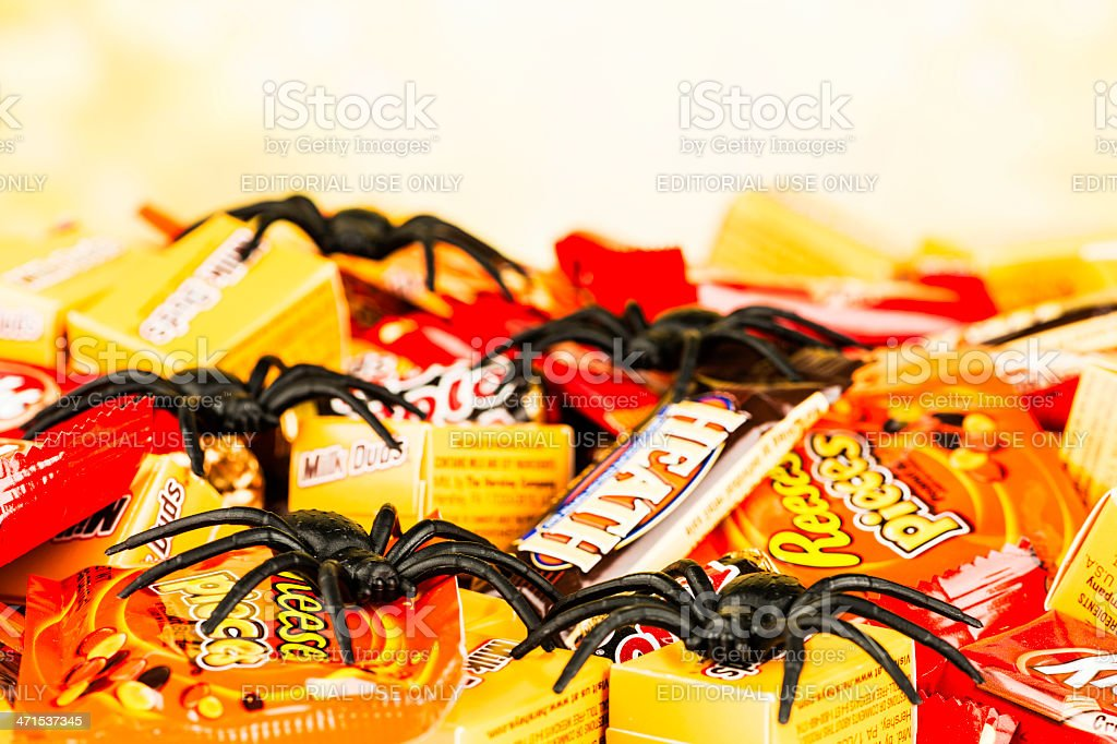 Chocolate Halloween Candy and Creepy Spiders royalty-free stock photo