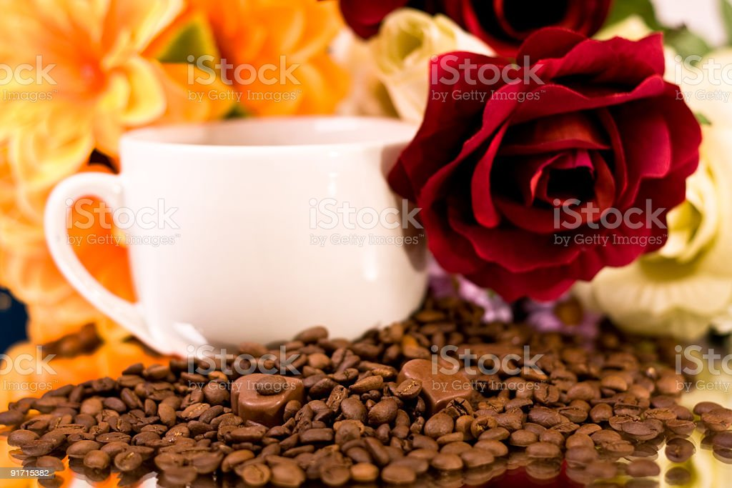 Chocolate heart coffee and flowers royalty-free stock photo
