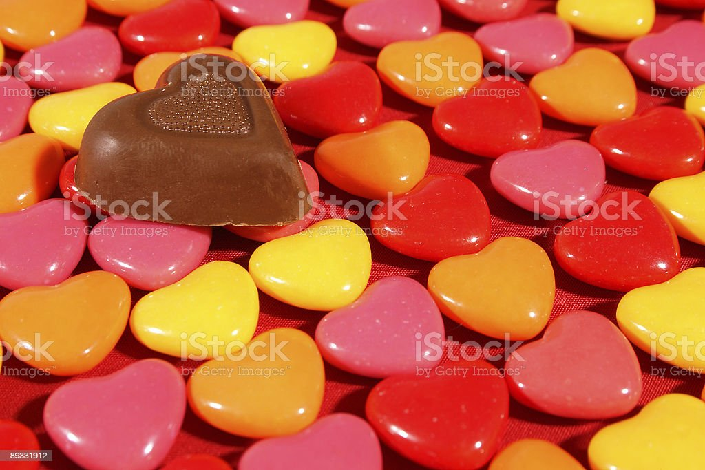 Chocolate heart on candies royalty-free stock photo