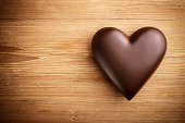 Chocolate heart on wooden background