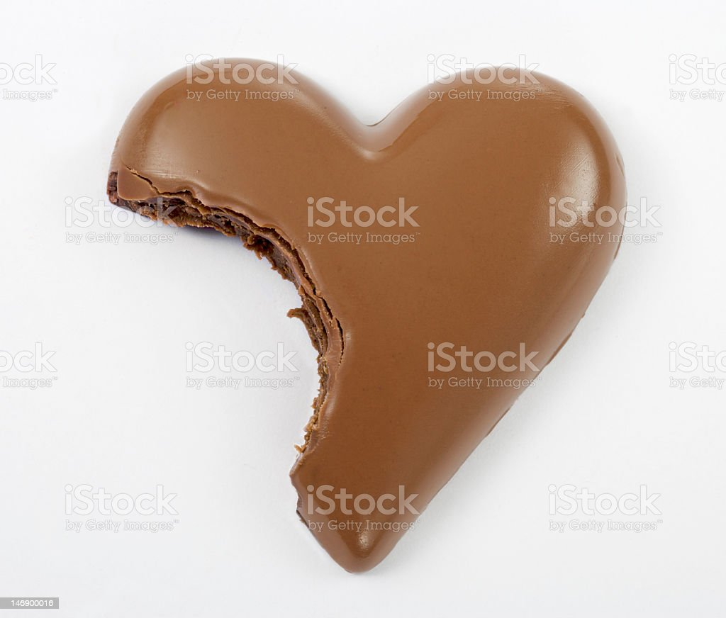Chocolate heart with a bite taken out stock photo