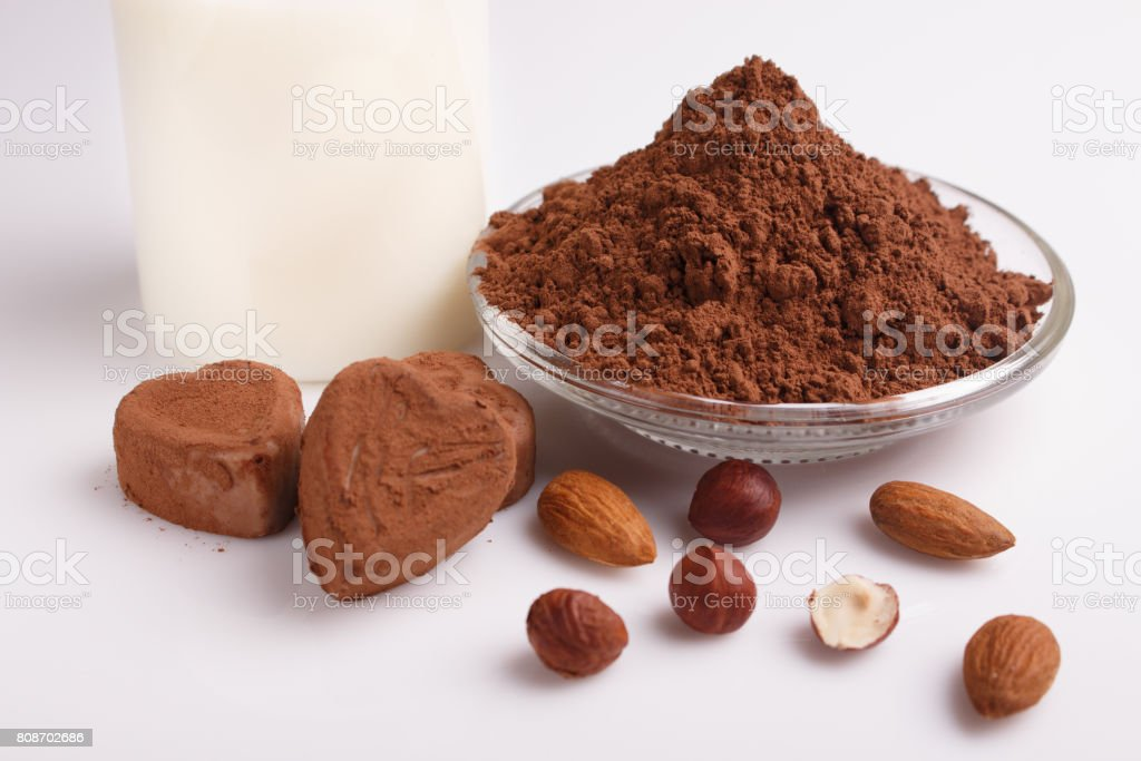 Chocolate heart-shaped candy on a white background, chocolate composition stock photo