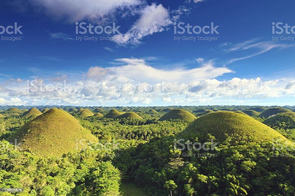 Chocolate Hills under blue sky in the Philippines. stock photo