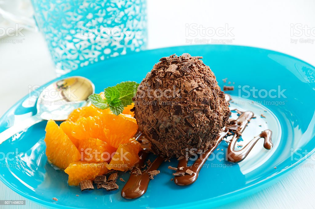 Chocolate ice cream in chocolate chips and oranges. stock photo
