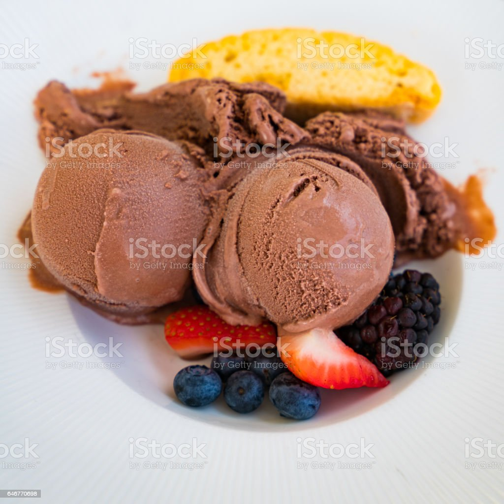 Chocolate ice cream with berries stock photo