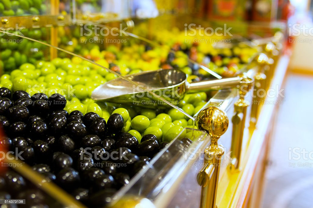 Chocolate icing olives in candy shop display stock photo