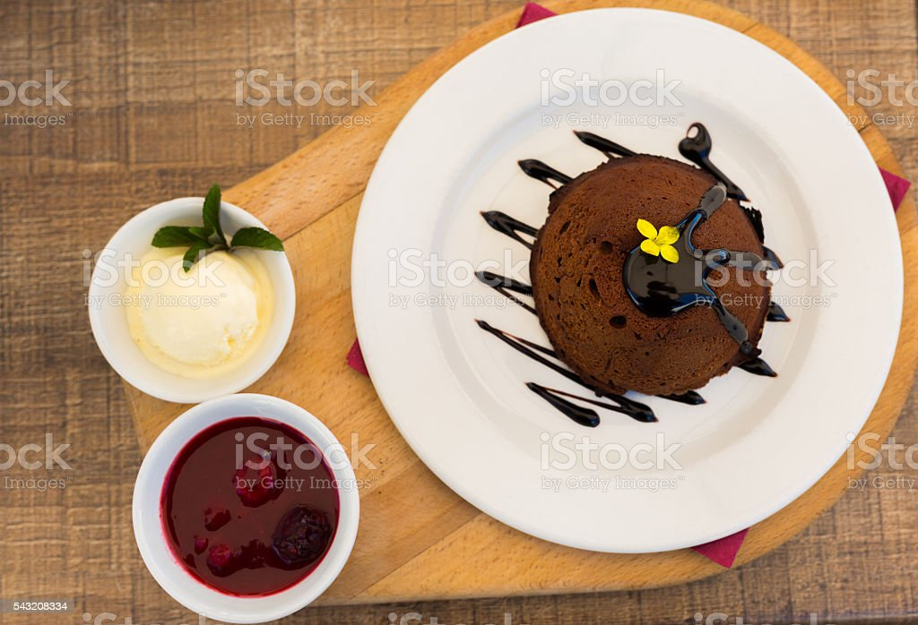 Chocolate lava cake with vanilla ice cream and raspberry. stock photo