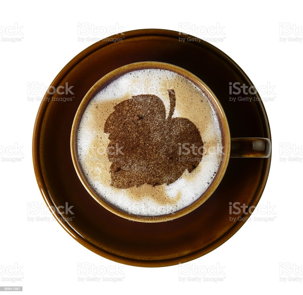 chocolate leaf on milk froth stock photo
