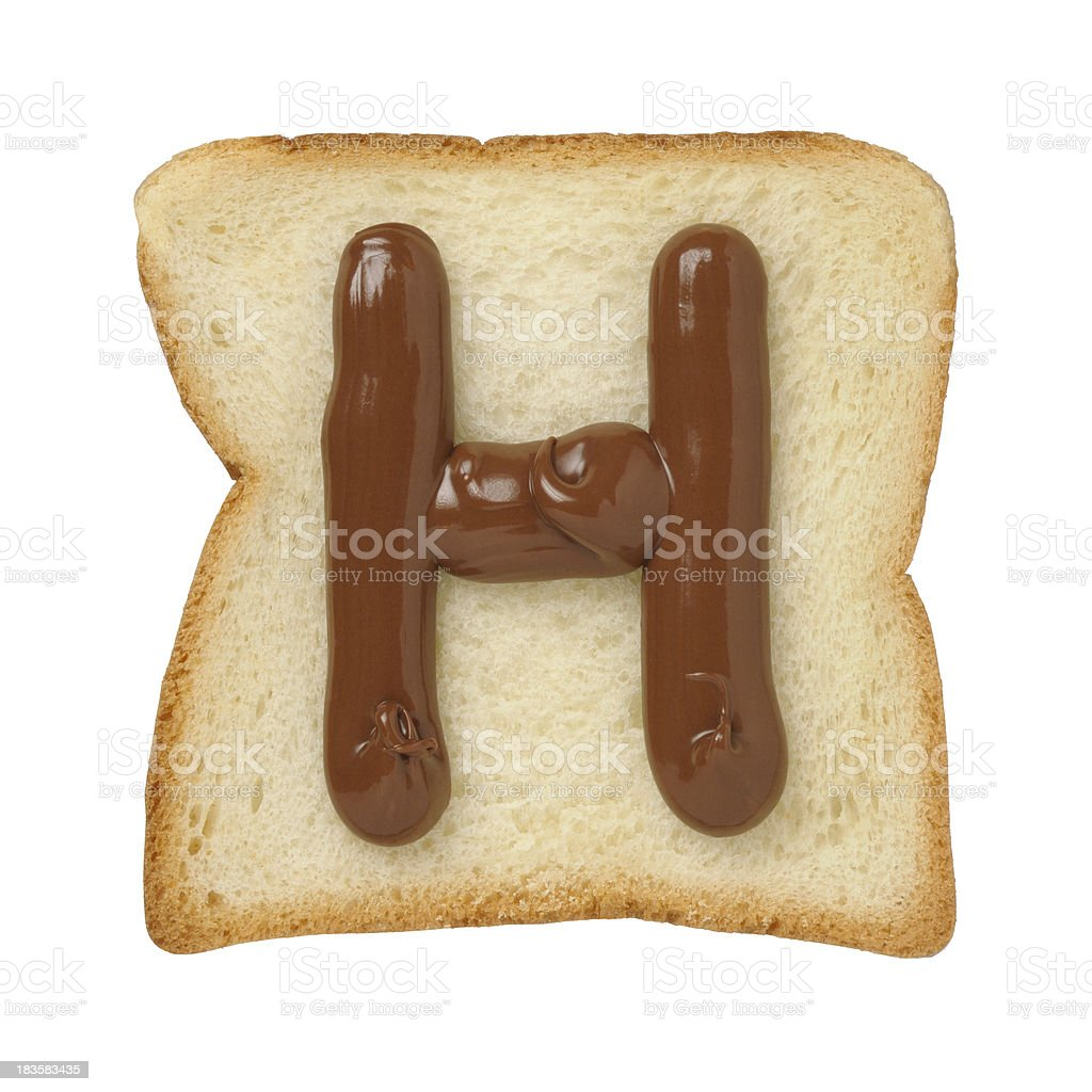 Chocolate letter H on a tinloaf slice, white background royalty-free stock photo