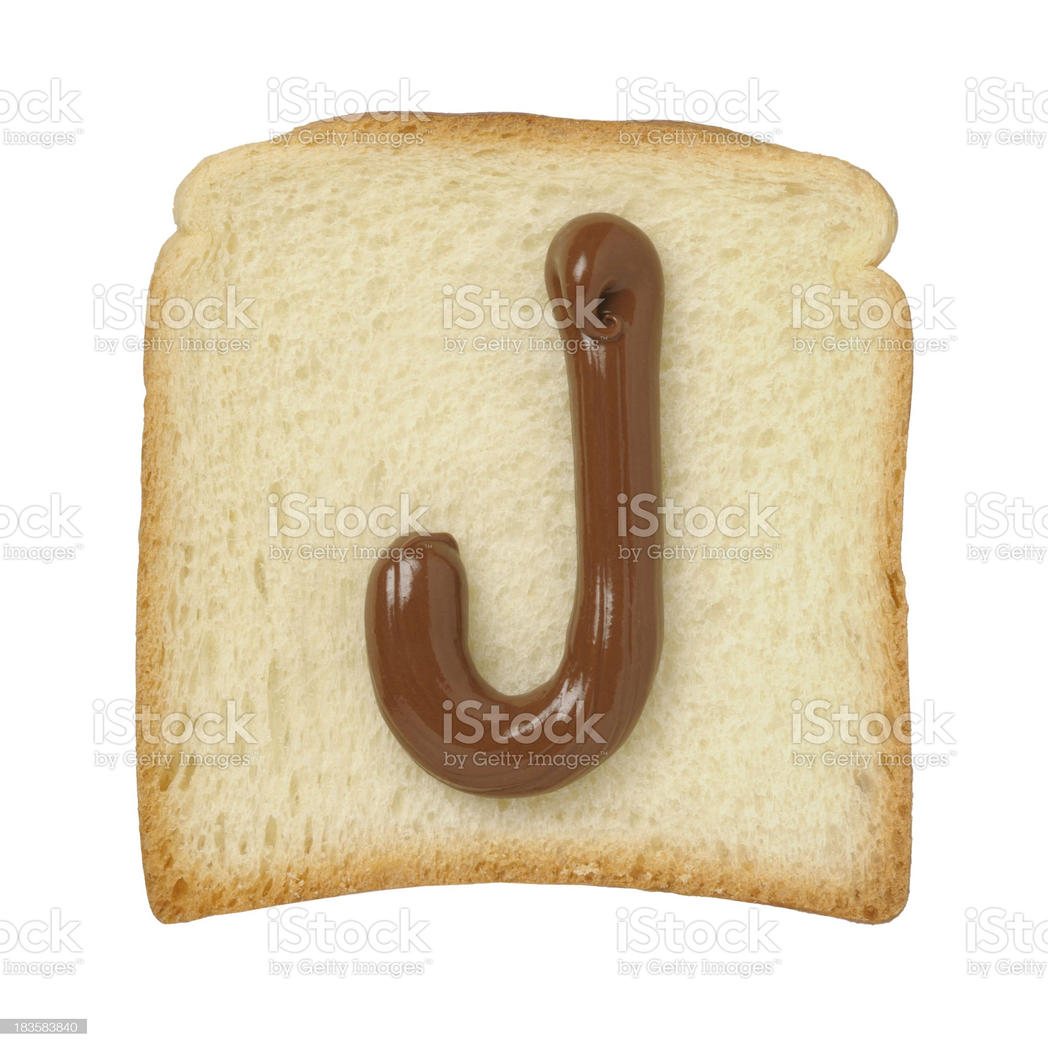 Chocolate letter J on a tinloaf slice, white background royalty-free stock photo