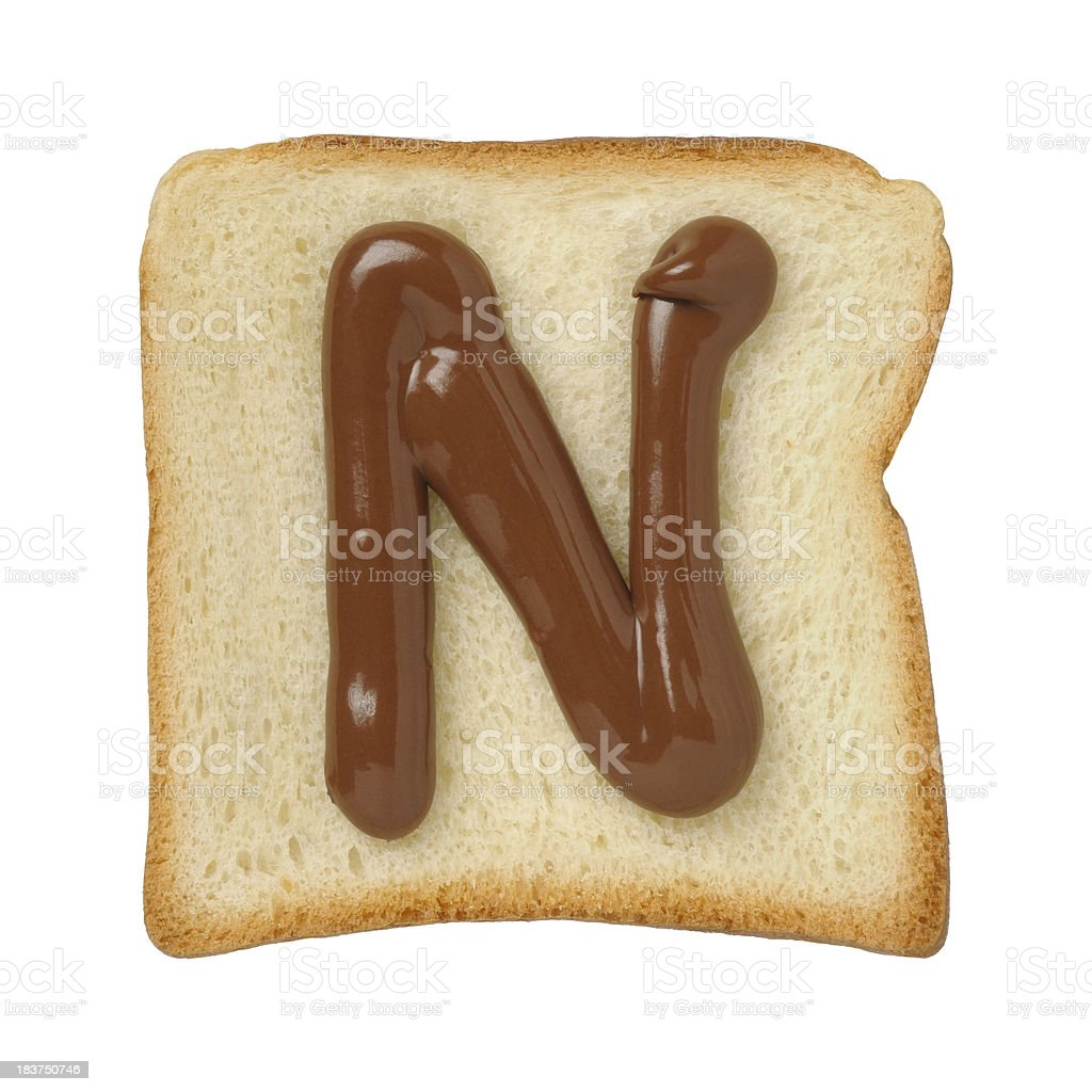 Chocolate letter N on a tinloaf slice, white background stock photo