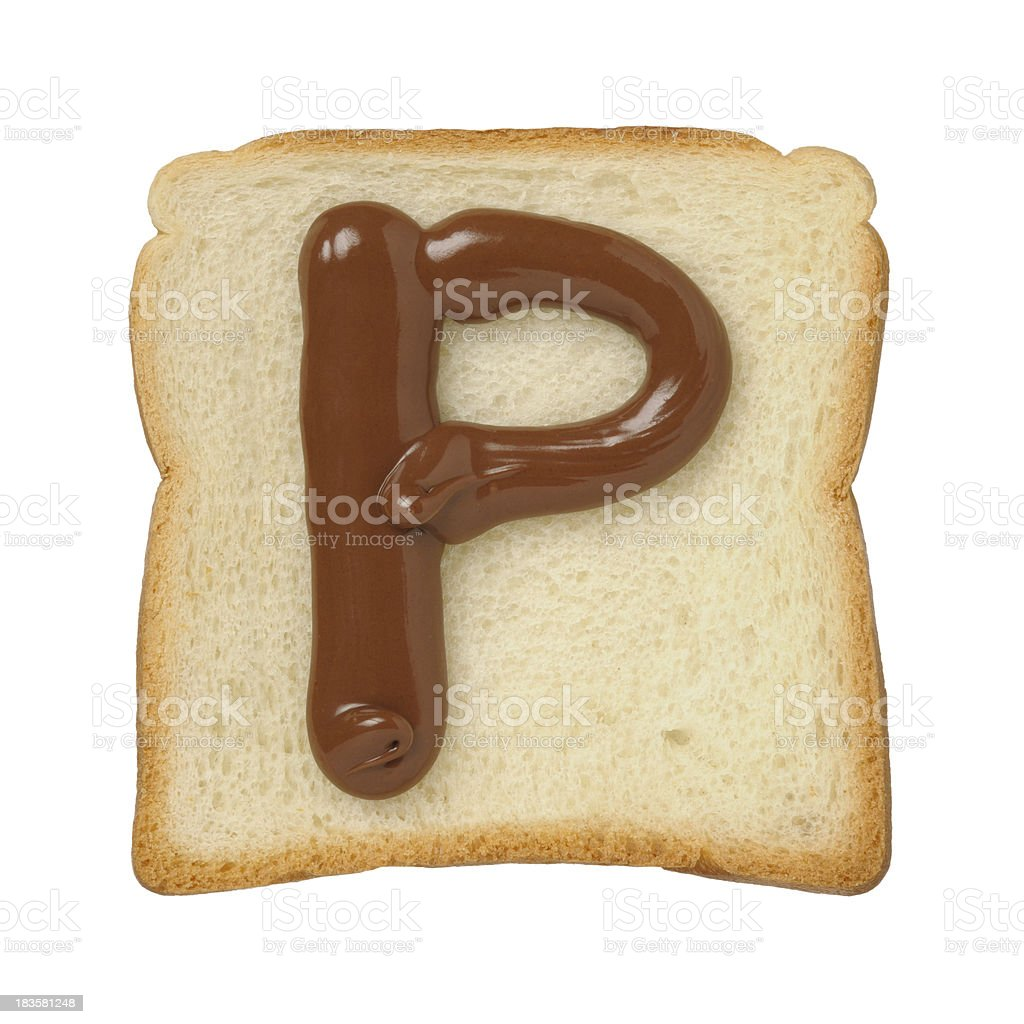Chocolate letter P on a tinloaf slice, white background royalty-free stock photo