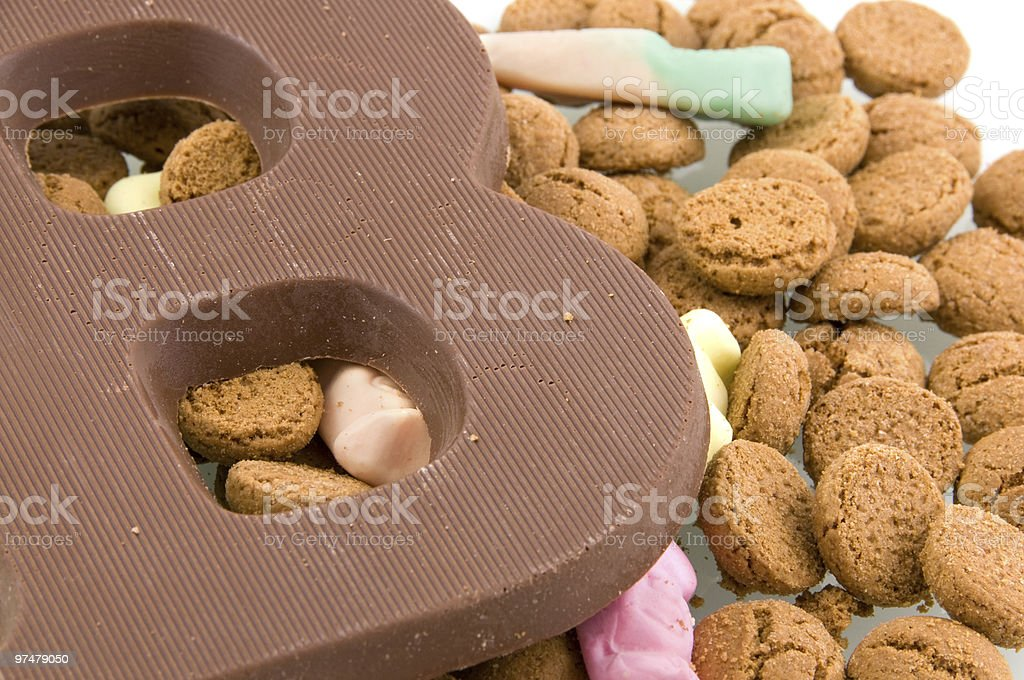 Chocolate letter with pepper nuts stock photo