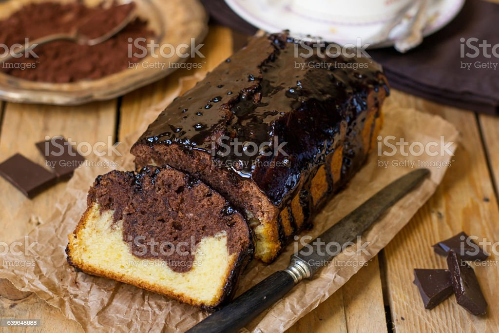 Chocolate loaf marble cake with chocolate glazing stock photo