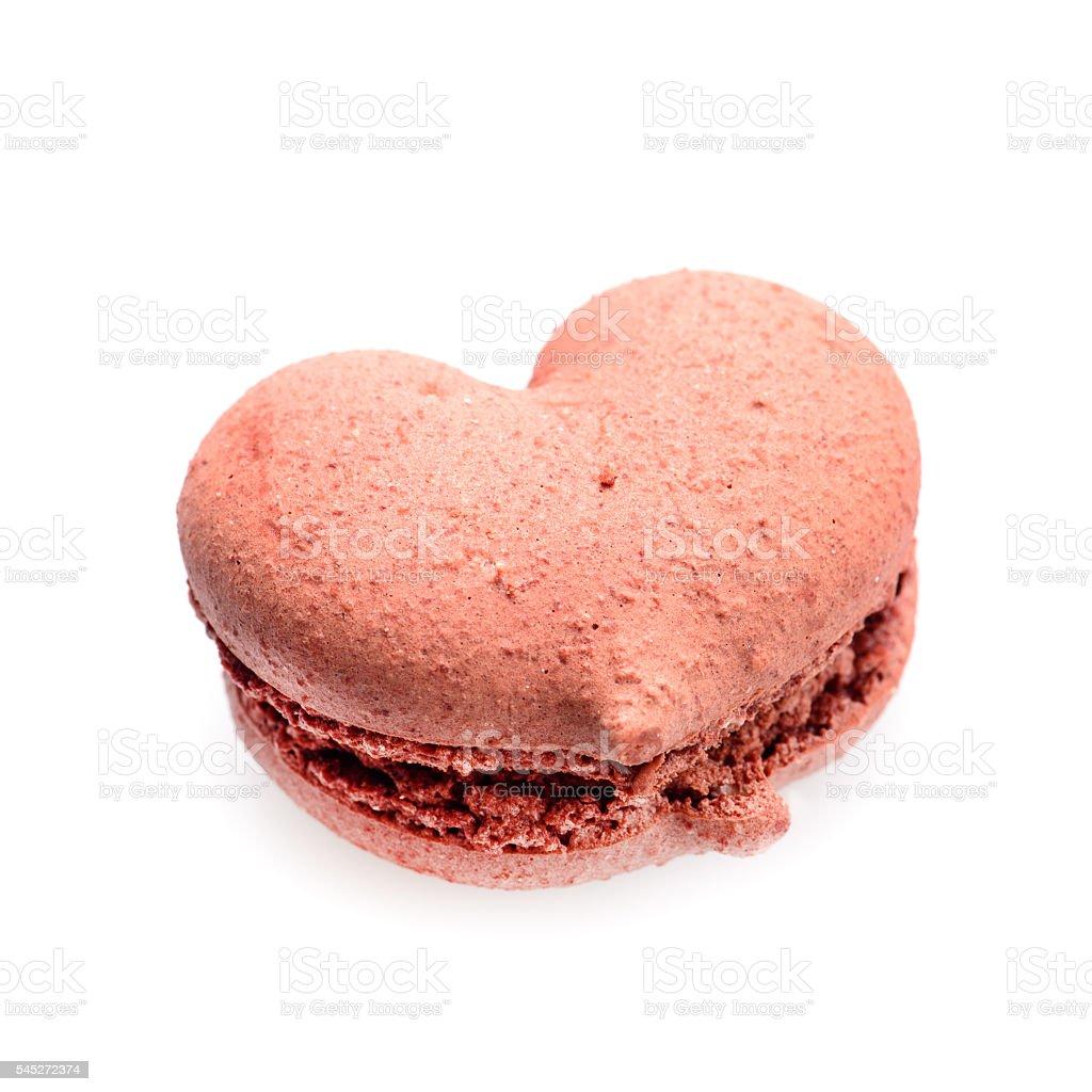 chocolate macaron in heart shape on white background stock photo