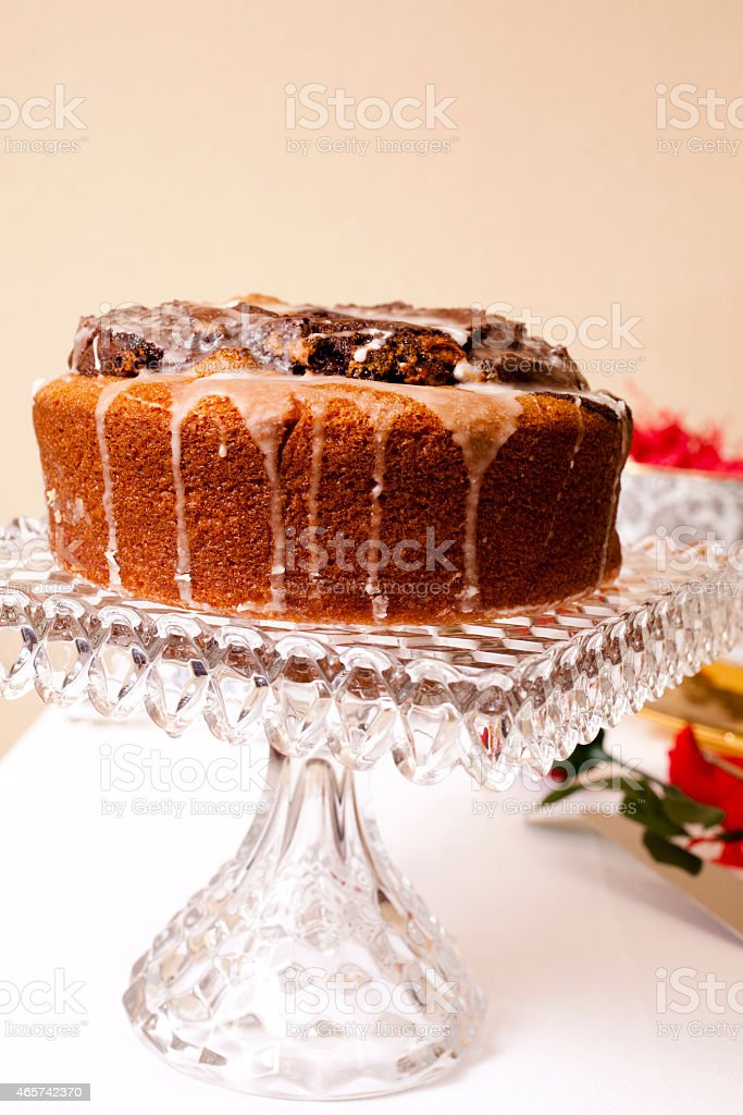 Chocolate marble pound cake, icing. Serving plate, knife, table. stock photo