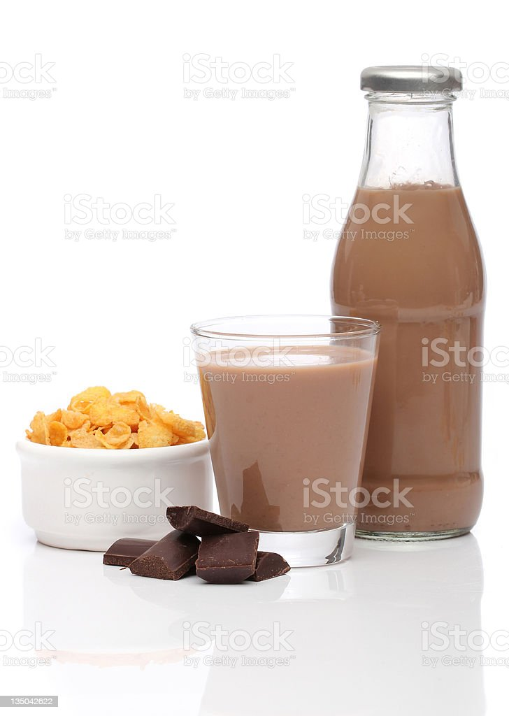 Chocolate milk and cornflakes over white background royalty-free stock photo