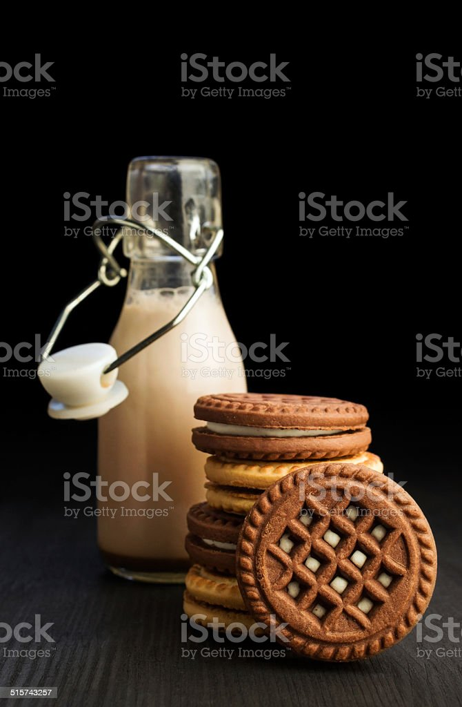 chocolate milk in a bottle with cookies stock photo
