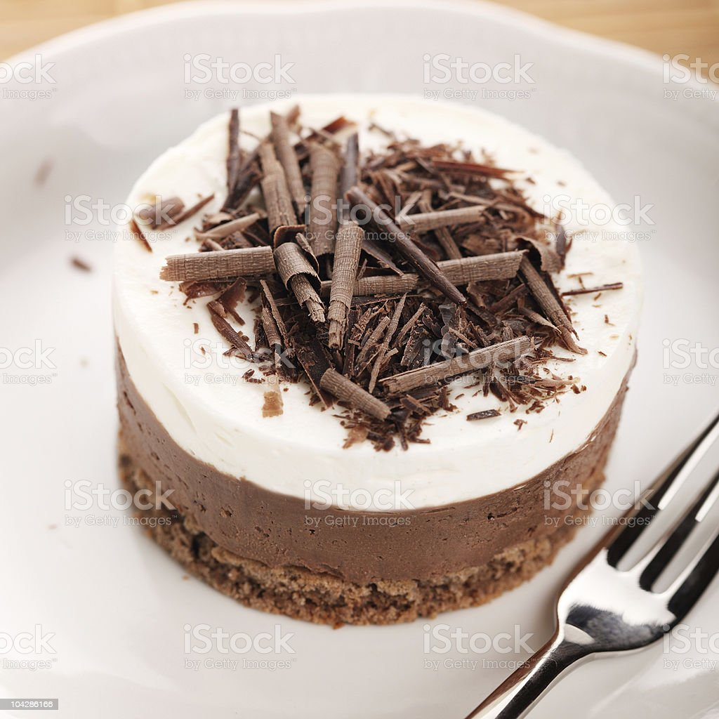 Chocolate moose dessert on a white plate stock photo