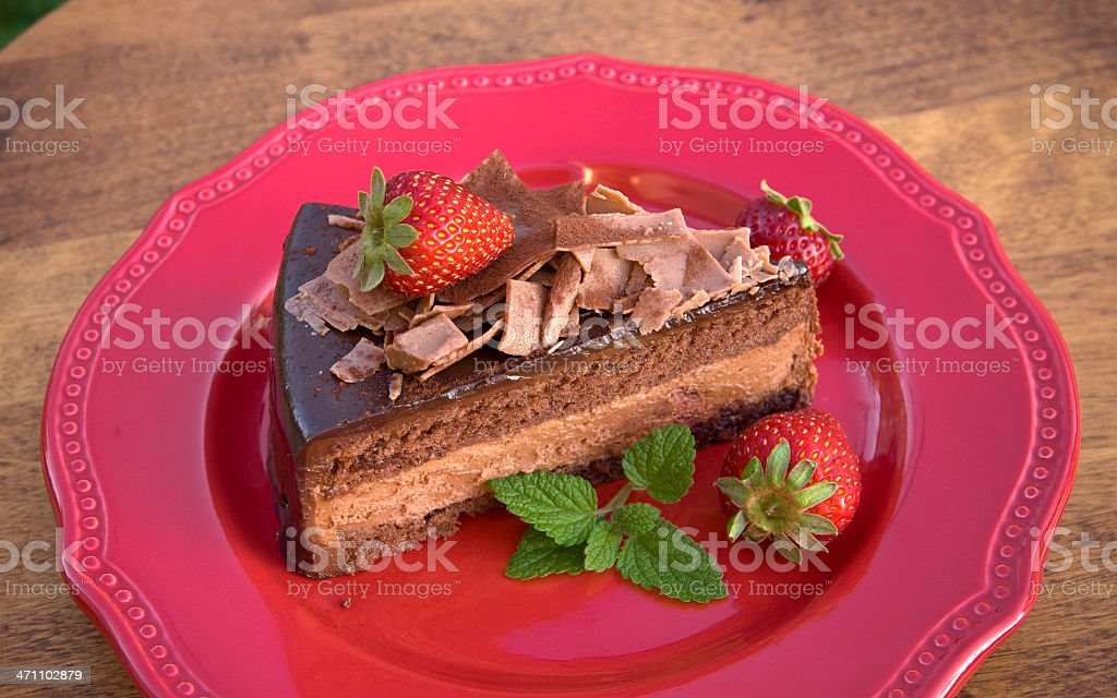Chocolate Mousse Cake Dessert with Fresh Strawberries on Red Plate stock photo
