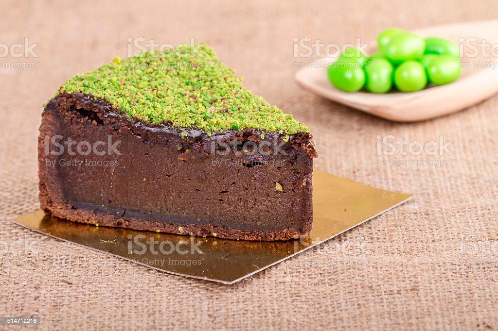 chocolate mousse cake slice on burlap background stock photo