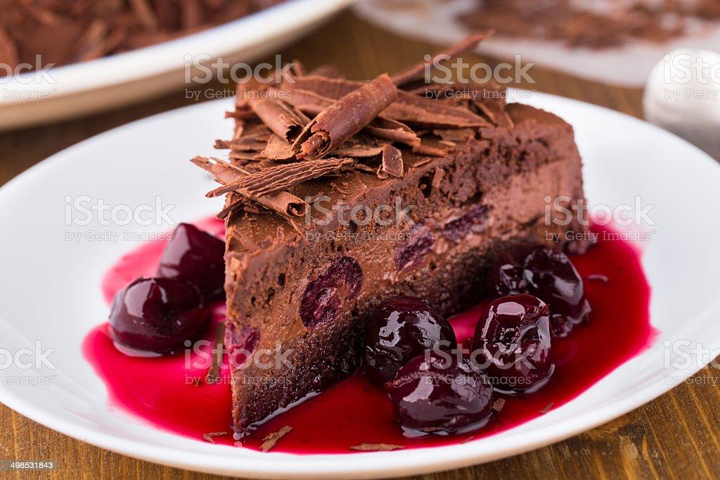Chocolate mousse cake with dark cherries stock photo