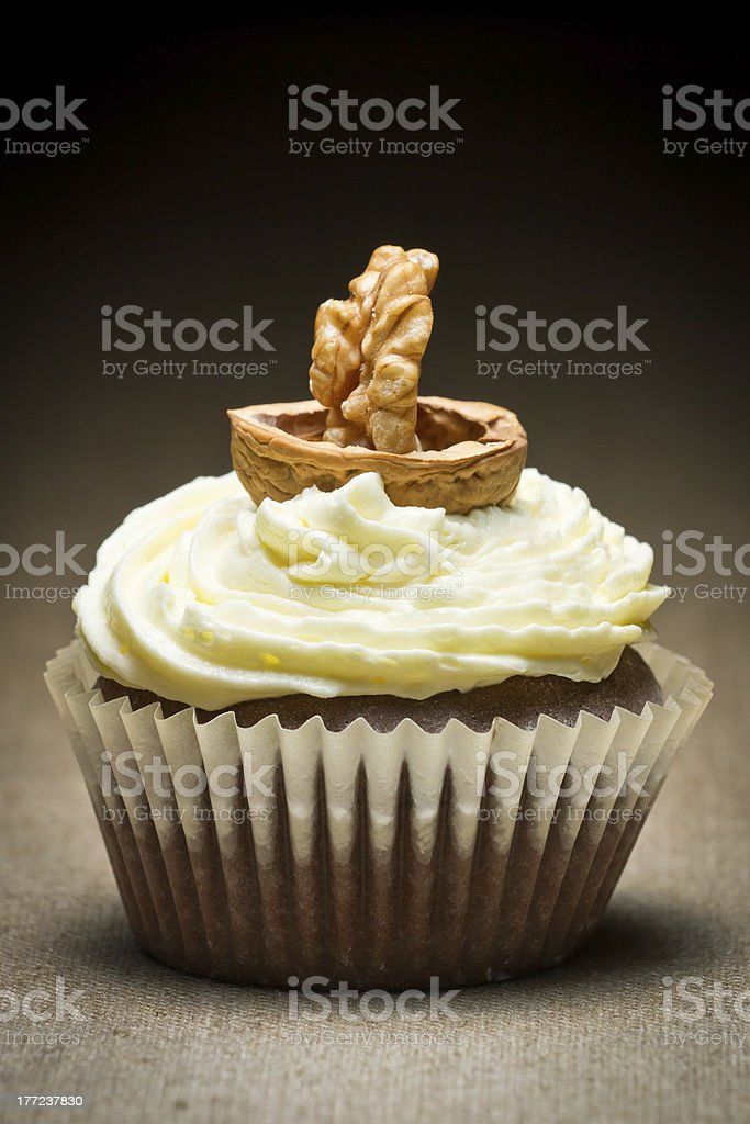 Chocolate muffin and vanilla cream with walnut looking like boat royalty-free stock photo