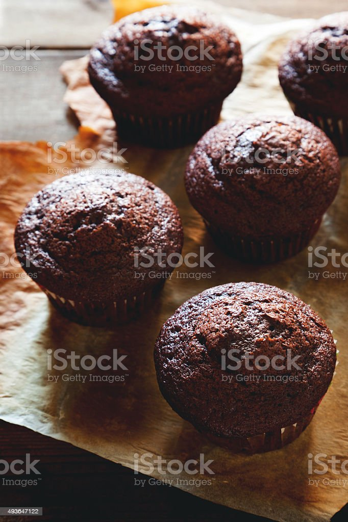 chocolate muffin on wooden table stock photo