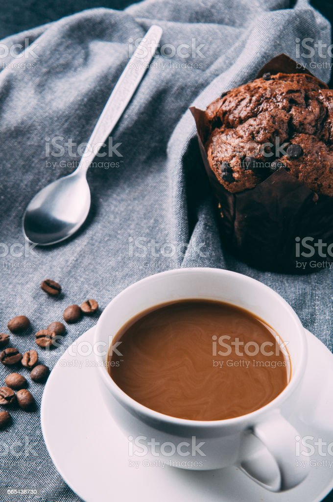 Chocolate muffins and coffee on a dark background stock photo